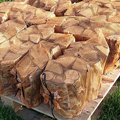 Kiln dried logs in nets