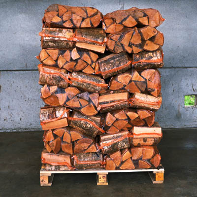 Kiln dried hardwood logs in nets